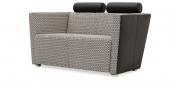 ARTHE - Sessel im Hahnentritt Muster von Sonnhaus und Kopfrolle in Leder